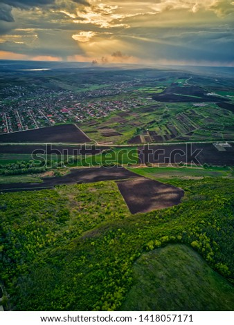 Flight over cultivating field in the spring at sunset. Moldova Republic of. #1418057171