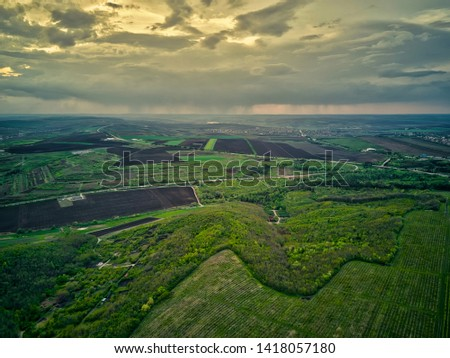 Flight over cultivating field in the spring at sunset. Moldova Republic of. #1418057180