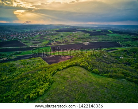 Flight over cultivating field in the spring at sunset. Moldova Republic of. #1422146036