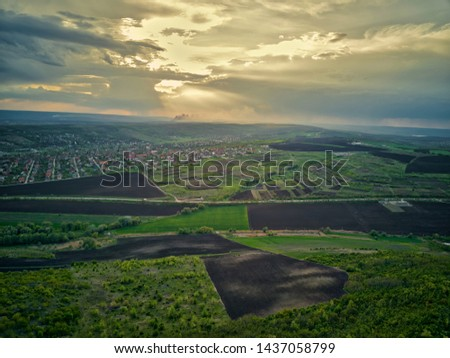 Flight over cultivating field in the spring at sunset. Moldova Republic of.