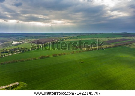 Flight over cultivating field in the spring. Moldova Republic of.