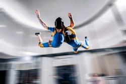 Flight simulation.  Peoples flight in wind tunnel. Indoor skydiving simulation.  Swim in wind tunnel. New  sport in flight technology simulation.