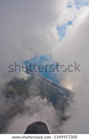 flight through the clouds view from the pilot, summer vacation in the Caucasus in Abkhazia. Saturated color. #1349957300