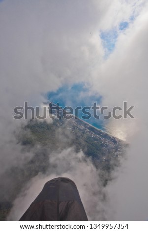 flight through the clouds view from the pilot, summer vacation in the Caucasus in Abkhazia. Saturated color. #1349957354
