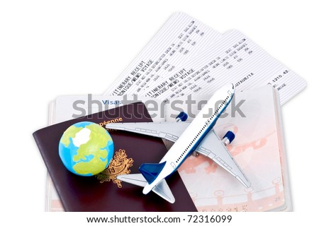 Flight tickets with passports, model of airplane and globe, isolated on white background.
