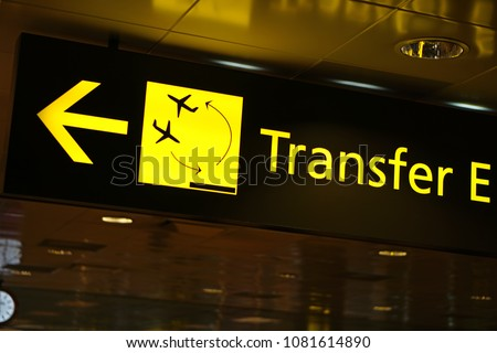Flight Transfer sign in airport                               #1081614890