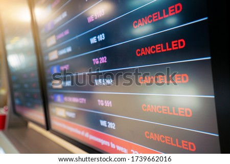 flights cancellation status on flights information board in airport because coronavirus or pandemic effected. flight cancellation, airline business crisis, airline bankrupt, tourism crisis concept Stockfoto ©
