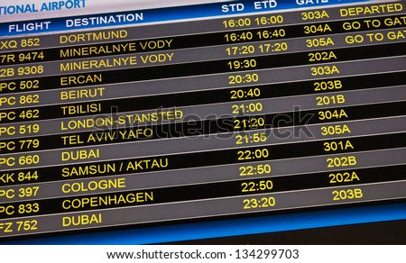 Flights departure information timetable in airport terminal