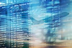 Flights information on modern departures board in airport terminal.