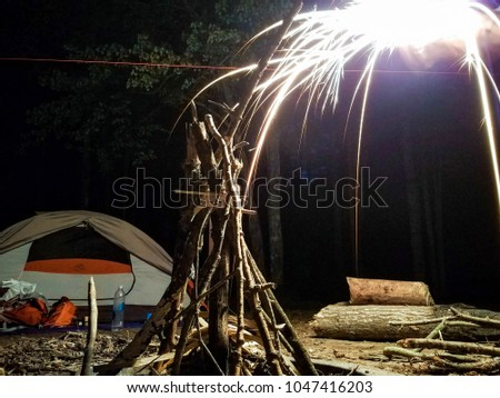 Stock Photo Flint sparks lighting the fire camping in front of the tent Manistee forest lumber fire wood