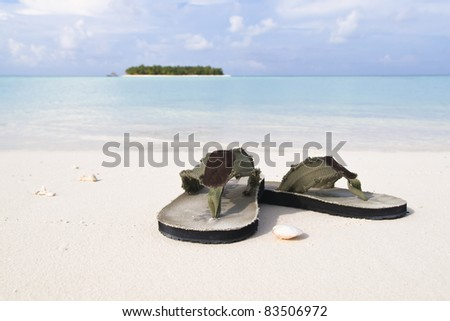 Flip-flop on white sand beach of a paradise island in Maldives