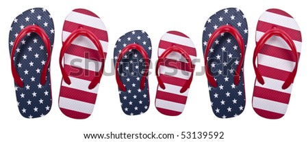 Flip Flop Sandals in American Red White and Blue in Two Large Sizes, and One Small Size Symbolize a Family. Isolated on White with a Clipping Path.