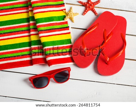 b1e3263886147a Flip flop shoes and sunglasses of young people near hotel pool  264811754