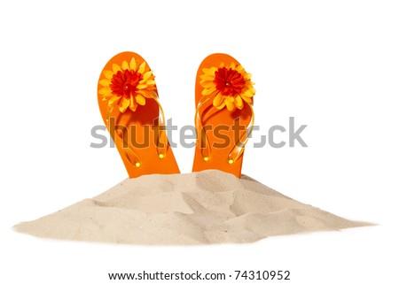 flip-flops on a sunny pile of sand