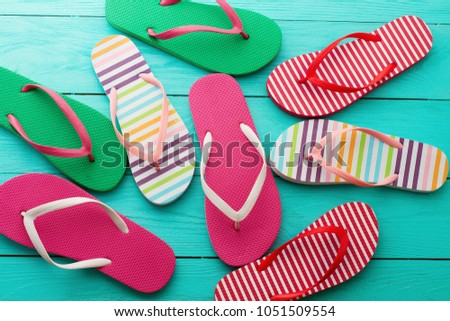 49e19eb812e2 flip flops on blue wooden floor background. Top view and copy space. Summer  fun