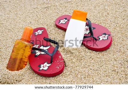 Flipflops and sunscreen on the beach with amazing colors