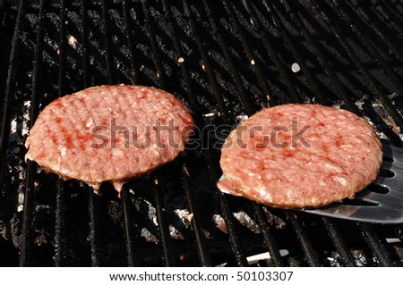 Flipping Hamburgers on the Grill with a Spatula