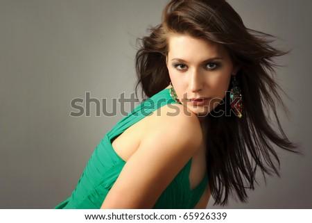 Flirting brunette woman with flying hair