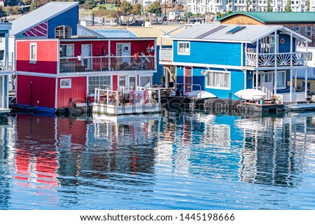 Float Homes/ floating houses on the waterfront at Fishermans Wharf in Victoria, Canada. Residents living on water in the harbour. These are colorful residential structures built on flotation systems. #1445198666