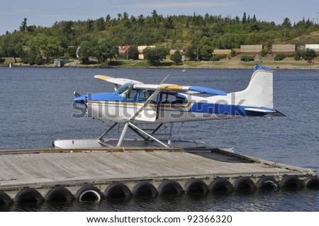 float plane on water by the dock