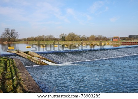 Floating Barrier and weir on the Thames flood relief River