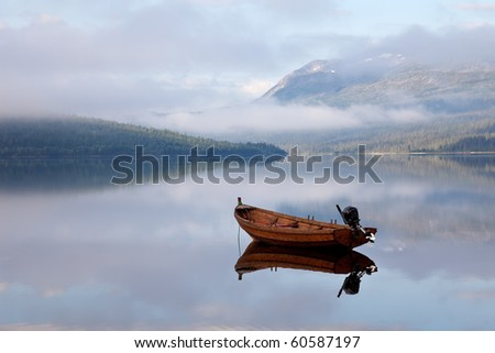 floating boat on mountain lake