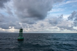 Floating buoy at sunset in the stunning Caribbean Sea under a cloudy sky off the coast of St. Croix in the USVI