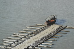 Floating buoy made from bamboo used as a path to board the boat, Sangkhla Buri, Kanchanaburi, Thailand.