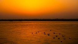 Floating candles or floating lights in the Ganges of India. It will be floating in the morning and evening by morning sunlight reflected orange with water.