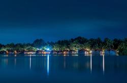 Floating cottages in Poovar island, Poovar Lake at night. Thiruvananthapuram, Kerala, India.