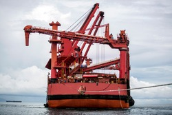 Floating Crane Pulled by Tugboat Rope