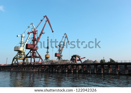 floating cranes over the river on the blue sky background