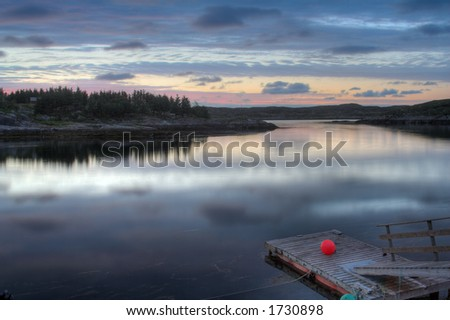 floating fisherman pier in sunset - in a Norwegian fjord.