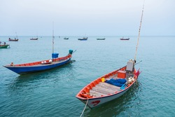Floating fishing boats aground at the harbor over cloudy sky at Chanthaburi, Thailand