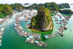 Floating fishing village and rock island in