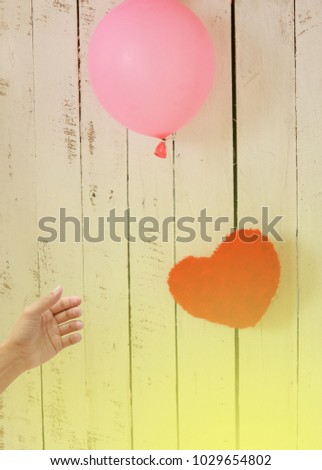 floating hearts with balloons wood background #1029654802