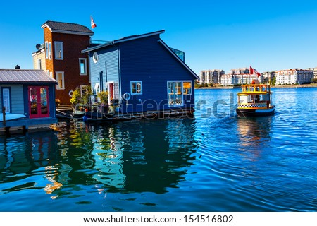 Floating Home Village Blue Houseboats Water Taxi Fisherman\'S Wharf Reflection Inner Harbor, Victoria British Columbia Canada Pacific Northwest. Area Has Floating Homes, Piers, Restaurants.