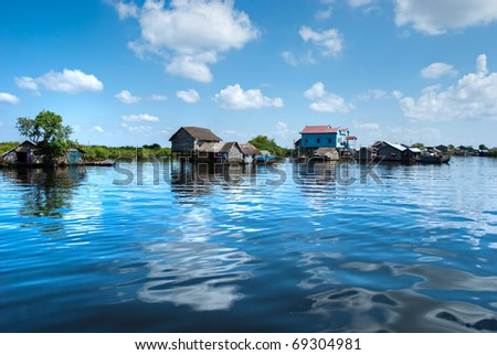 Floating House and  Houseboat on the Tonle Sap lake, between Battambang and Siem reap. Cambodia.