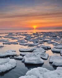 Floating ice on Lake Huron Sunrise. Port Hope, Michigan USA