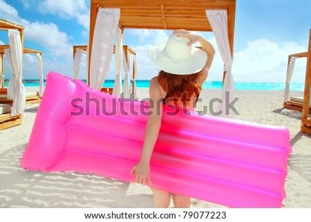 floating lounge pink girl in gazebo caribbean tropical beach Mexico