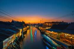 Floating market at night in Amphawa, Samut Songkhram Province, Thailand.