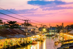 Floating market food at night in the river at Amphawa, Samut Songkhram Province, Thailand. The culture travel local boat in canal water. The Asia tourism concept