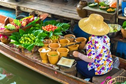 Floating market in Thailand in a summer day