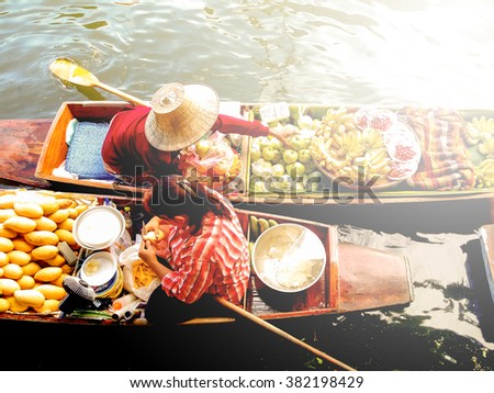 Floating market in Thailand in vintage photo style with intentional sun glow effect applied