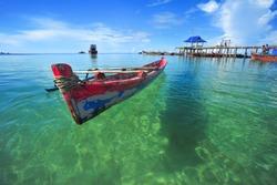 Floating Old Boat at Trikora Beach Bintan Island Indonesia