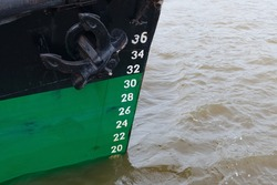 Floating ship with draft measurement scale at the bow