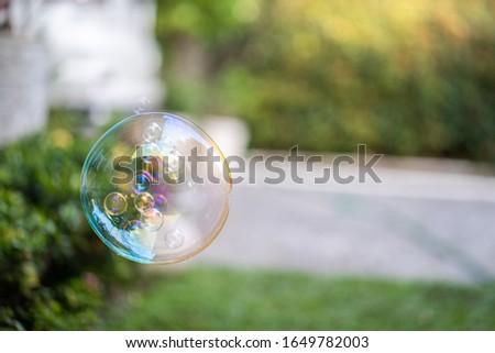 Floating soap bubbles in garden.