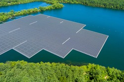 Floating solar panels platform on the beautiful lake renewable alternative electricity energy of panorama aerial view