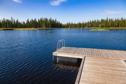 Floating swimming raft dock on a forest lake in Central Norway