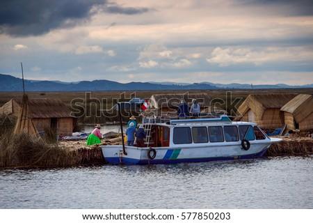 Floating Uros island, Lake Titicaca, Peru #577850203